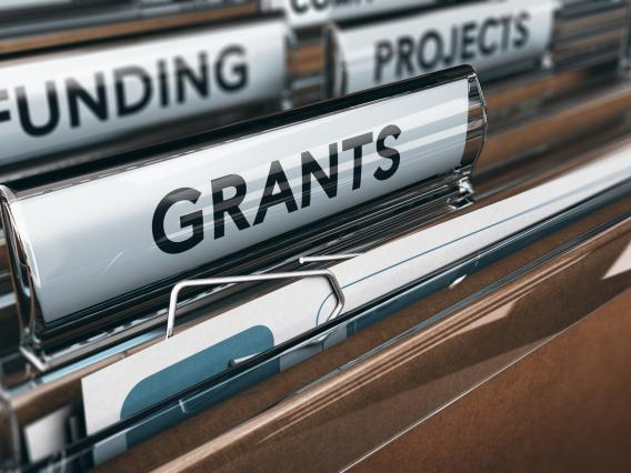 hanging file folders labeled grants, funding and projects
